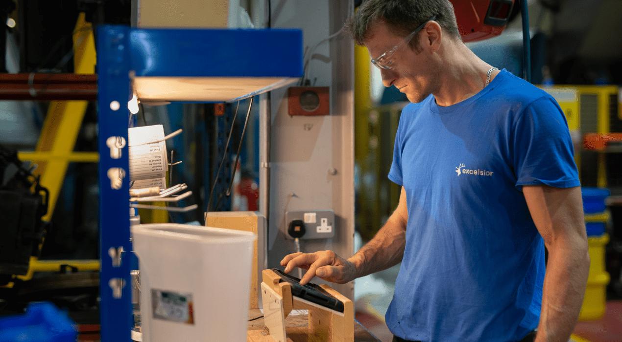 man operating roto moulding machine